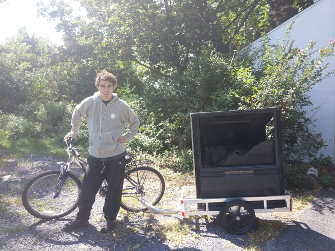 drew-next-to-tv-on-bike-trailer